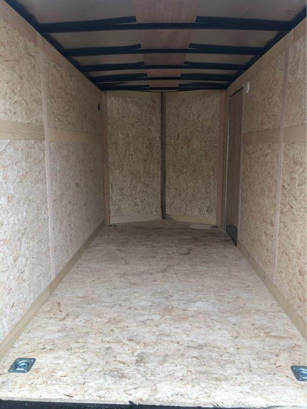 6 x 12  Haulmark Pass Port Model 6ft 6in Interior Height.
