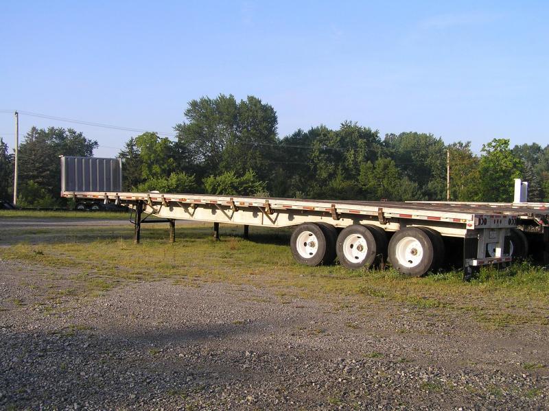 2004 Trans Spec tri-axle Flat Bed