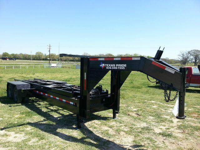 TEXAS PRIDE Dual Tandem Roll Off Dump with five 18-Yard-Dumpsters