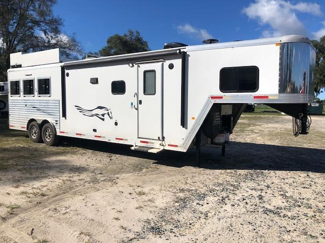2016 Merhow Trailers 8' wide 3 horse w/12' lq slide and generator Horse Trailer