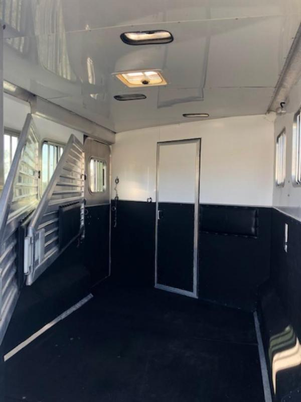 2005 Featherlite 8' wide 3 horse w/10' lq midtack and gen. Horse Trailer