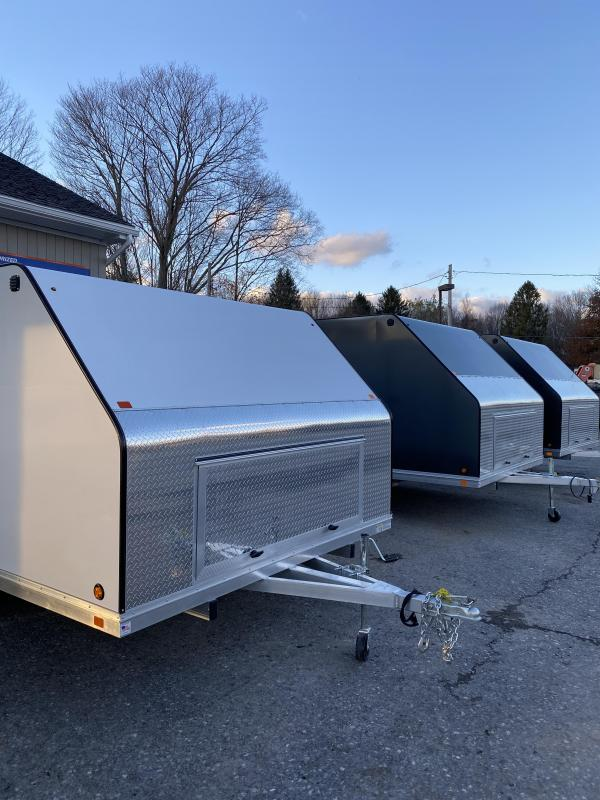 2021 Blizzard Manufacturing NOR-EASTER 12 Snowmobile Trailer BASE PRICE $4550.00WITH OPTIONS:SIDE MAN DOOR $245.00INSTALLED GRABBERS AND SLIDES $480.00