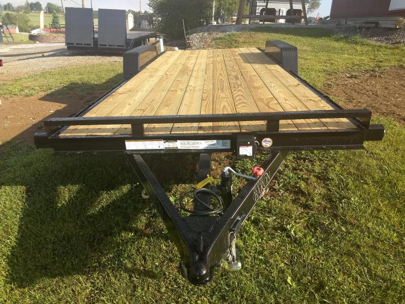 Pro Grade Wood Deck Car Hauler 20 10K Removeable DR Side Ramp 5 Self Storing Ramps 5 Channel Frame 5 Channel Tongue 2 Dovetail Sealed Beam Lighting Heavy Duty Fenders 15 Nitrogen Filled Radial Tires