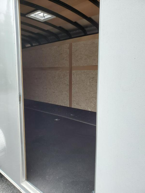 "2020 Wells Cargo- 7'x16'- Road Force Enclosed Cargo Trailer- ""Landscaper Package""- 6'6"" Interior Height- 36"" Side Entry Door-78""x72"" Rear Ramp Door- Recessed D-Ring in Floor- Black Non-Slip Flooring- Full Width Aluminum Ramp Extension- Silver .030 Aluminu"