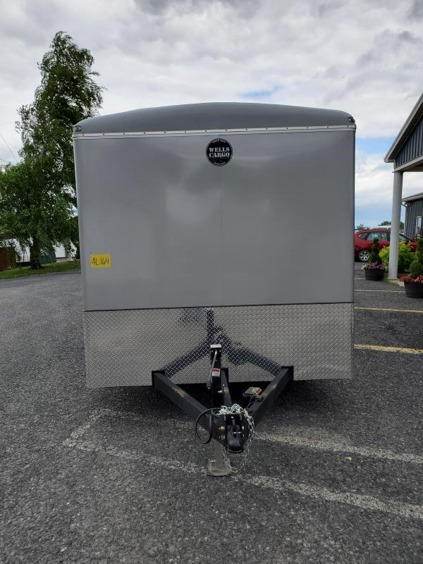 "Wells Cargo 7'x16' Wagon HD Enclosed Cargo Trailer- 7K GVWR- 6'8"" Interior Height- 76""x69""Rear Ramp Door- 2 5/16"" Coupler- 1 Piece Aluminum Roof- 7-Way 12V End Connector- 3/4"" Plex Core Flooring- 3/8"" Plex Core Interior Side Walls- .030 Bonded Alumin"