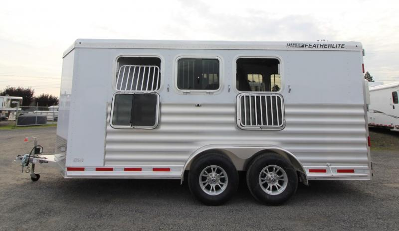 2020 Featherlite 7441 - w/ Rear Tack - Large Dressing Room 3 Horse Trailer - Drop down feed windows - 2 Tier saddle rack - Drop down face bars headside