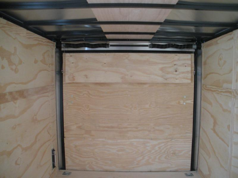 "2020  Spartan 7' X 12' 7K Black w/ ""Black Trim Pkg."" Motorcycle Pkg. Semi-Screwless Enclosed Cargo Trailer Due in Late October"