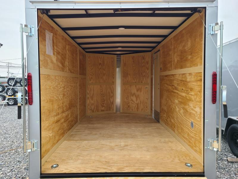 """7 x 12 Homesteader Intrepid V-Nose Cargo, 7k  **Silver w/ 6"""" Extra Height & Ramp Door Pkg."""