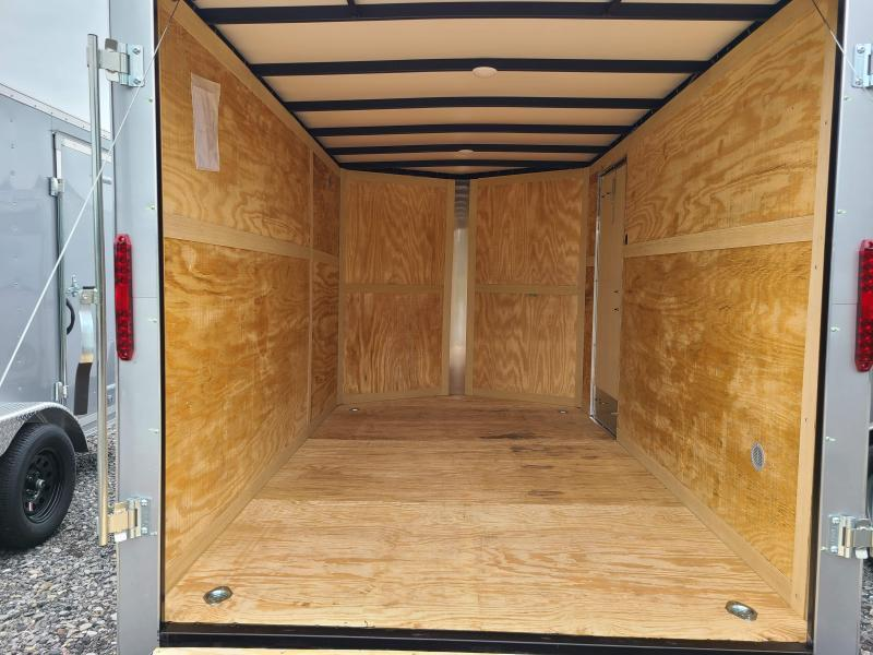 "7 x 12 Homesteader Intrepid V-Nose Cargo Trailer, 3k  **White w/ 6"" Extra Height & Ramp Door Pkg."