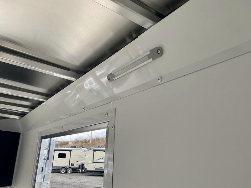 """2021 Neo 7x26' NASF Aluminum Enclosed All-Sport Trailer 7000# GVW * 7' HEIGHT UTV PKG * BLACK/SILVER EXTERIOR * FRONT/REAR NXP RAMP * VINYL WALLS * SPORT TIE DOWN SYSTEM * 16"""" O.C. FLOOR * PRO STAB JACKS * UPPER CABINET * 3 LOADING LIGHTS * 2-TONE JD SLAS"""