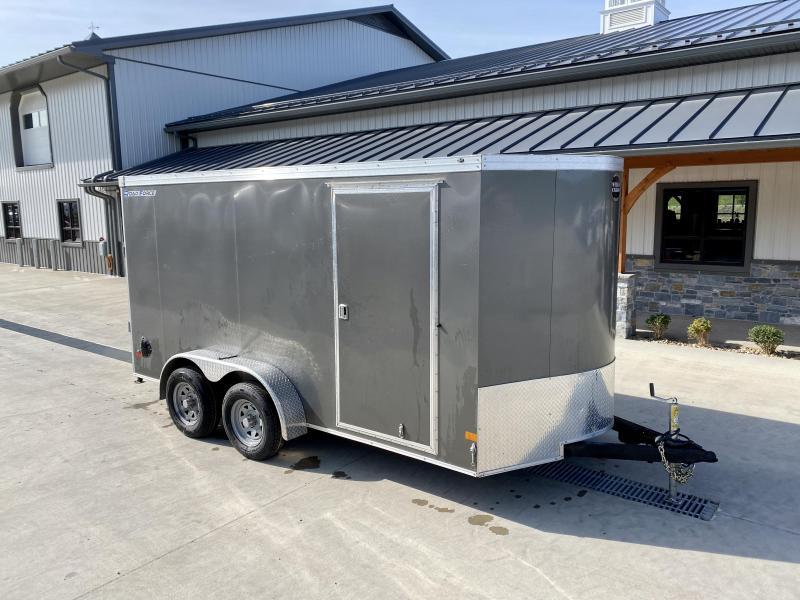"USED 2021 Wells Cargo 7x14' Enclosed Motorcycle Trailer 7000# GVW * CHARCOAL EXTERIOR * 6'6"" INTERIOR HEIGHT * D-RINGS * SCREWLESS * STABILIZER JACKS * WHEEL CHOCK * TRANSITION PLATE * RAMP DOOR * RV DOOR"