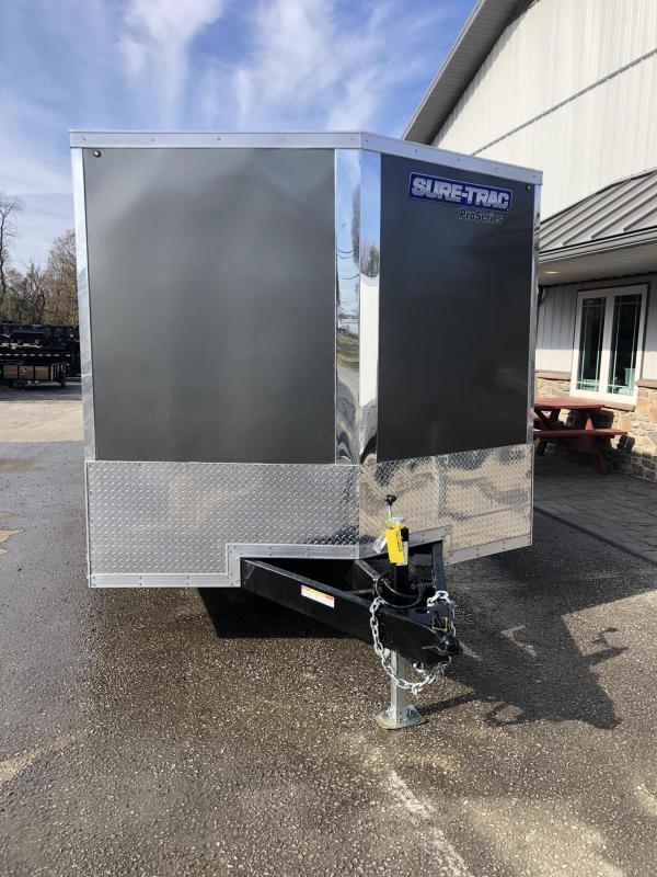 "2021 Sure-Trac 8.5x24' Deluxe Pro Series Enclosed Car Hauler Trailer 9900# GVW * CHARCOAL EXTERIOR * V-NOSE * RAMP * 5200# TORSION AXLES * NUDO FLOOR & RAMP * VINYL WALLS * ESCAPE HATCH * .030 SCREWLESS EXTERIOR * ALUMINUM WHEELS * 1 PC ROOF * 48"" RV DOOR"