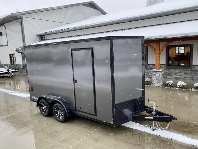 "2021 Sure-Trac 7x14' Enclosed Cargo Trailer 7000# GVW * CHARCOAL EXTERIOR * BLACKOUT TRIM PACKAGE * TORSION * .030 SCREWLESS * ALUM WHEELS * 1PC ROOF * 7' UTV HEIGHT * 6"" FRAME * LED LIGHTS * BACKUP LIGHTS"