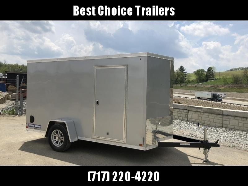 "2021 Sure-Trac 6x10' Pro Series Enclosed Cargo Trailer 2990# GVW * SILVER EXTERIOR * V-NOSE * RAMP * .030 SCREWLESS EXTERIOR * ALUMINUM WHEELS * 1 PC ROOF * 4"" TUBE FRAME * 16"" O.C. WALLS * PLYWOOD * TUBE STUDS * CEILING LINER * RV DOOR"