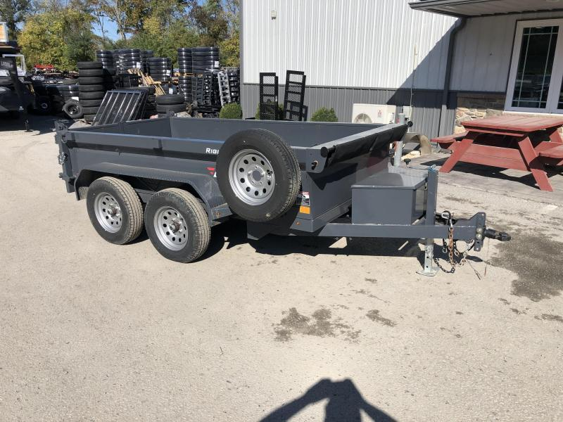 "USED 2018 Lamar 5x10' Deluxe Dump Trailer 7000# GVW * DELUXE TARP KIT * SPARE TIRE * UNDERMOUNT RAMPS * CHARCOAL * ADJUSTABLE COUPLER * RIGID RAILS * 110V CHARGER * DOUBLE CHANNEL FRAME * 10GA FLOOR * POWER UP/DOWN * 4"" CHANNEL BED FRAME"