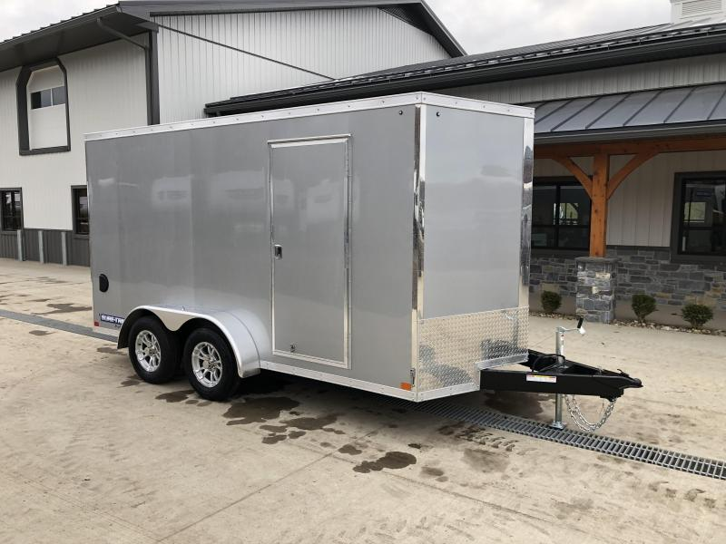 "2021 Sure-Trac 7x14' Pro Series Enclosed Cargo Trailer 7000# GVW * SILVER EXTERIOR * V-NOSE * RAMP * .030 SCREWLESS EXTERIOR * ALUMINUM WHEELS * 1 PC ROOF * 6'6"" HEIGHT * 6"" FRAME * 16"" O.C. C/M * PLYWOOD * TUBE STUDS"