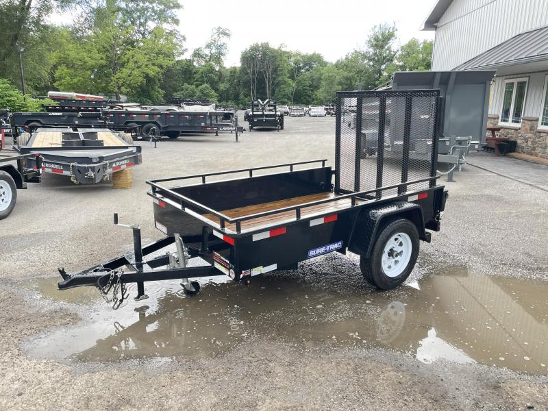 """USED 2018 Sure-Trac 5x8' Solid Side Utility Landscape Trailer 2990# GVW * 2X2"""" TUBE GATE C/M + SPRING ASSIST * FOLD FLAT GATE * TOOLESS GATE REMOVAL * SPARE MOUNT * PROTECTED WIRING * SET BACK JACK * TRIPLE TUBE TONGUE * HD FENDERS * TUBE BUMPER * HIGH SI"""