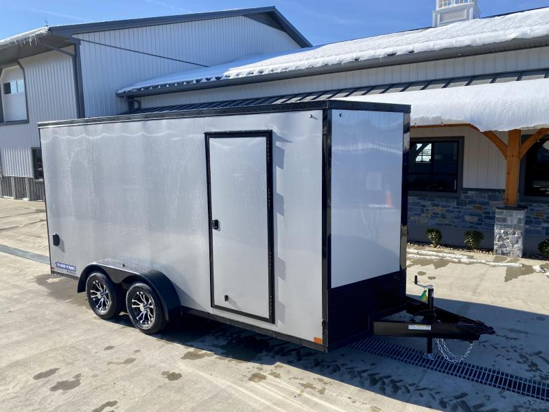 "2021 Sure-Trac 7x16' Enclosed Cargo Trailer 7000# GVW * SILVER EXTERIOR * BLACKOUT TRIM PACKAGE * TORSION * .030 SCREWLESS * ALUM WHEELS * 1PC ROOF * 7' UTV HEIGHT * 6"" FRAME * LED LIGHTS * BACKUP LIGHTS * 22"" LOADING LIGHTBAR"