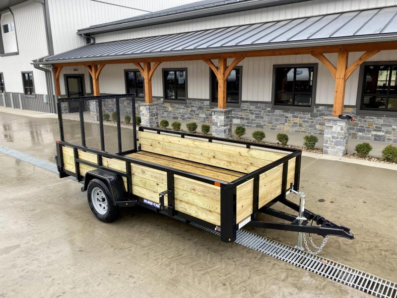 "2021 Sure-Trac 6x12' High Side Utility Landscape Trailer 2990# GVW * 24"" 3-BOARD HIGH SIDE * 2"" TUBE TOP RAIL * 2X2"" TUBE GATE C/M + SPRING ASSIST + FOLD FLAT * TOOLESS GATE REMOVAL * SPARE MOUNT * PROTECTED WIRING * SET BACK JACK * TRIPLE TUBE TONGUE * D"