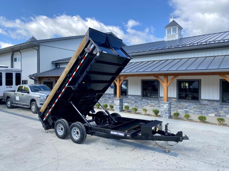 USED 2020 Sure-Trac 7x14' Dump Trailer 14000# GVW * DELUXE TARP KIT * DUAL PISTON * FRONT/REAR BULKHEAD * INTEGRATED KEYWAY * 2' SIDES * UNDERBODY TOOL TRAY * ADJUSTABLE COUPLER * 110V CHARGER * UNDERMOUNT RAMPS * COMBO GATE