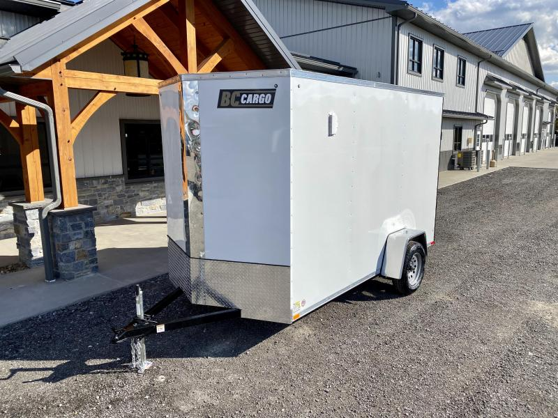 "2021 ITI Cargo 6x12'' Enclosed Cargo Trailer 2990# GVW * WHITE EXTERIOR * .030 SEMI-SCREWLESS * 1 PC ROOF * 3/8"" WALLS * 3/4"" FLOOR * 16"" STONEGUARD * HIGH GLOSS PAINTED FRAME * 7' INTERIOR HEIGHT"