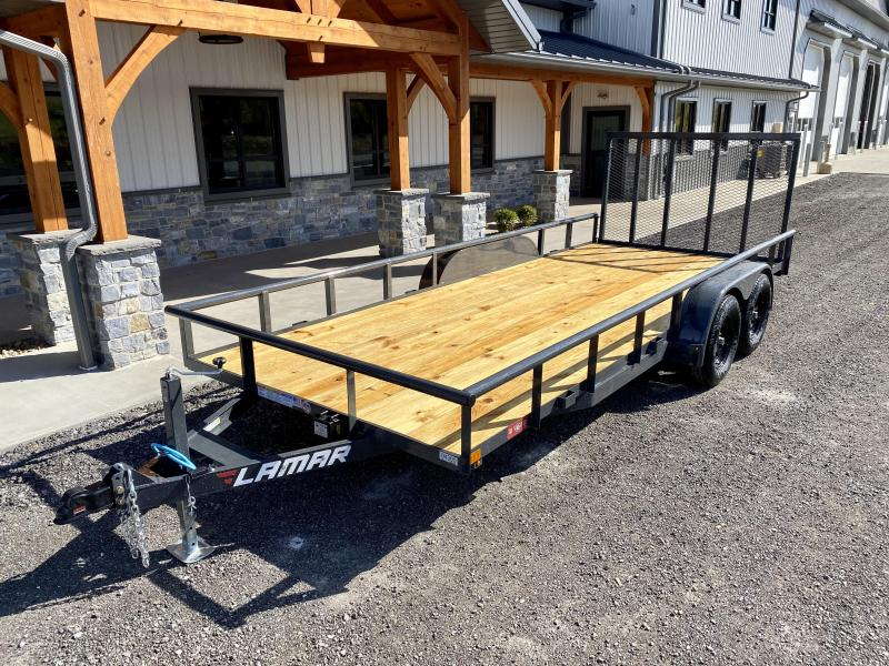 "2021 Lamar 7x18' Deluxe Utility Landscape Trailer 7000# GVW * ADJUSTABLE COUPLER * PIPE TOP RAIL * 7K DROP LEG JACK * CHARCOAL * HD GATE/2X2"" TUBE C/M + SPRING ASSIST * COLD WEATHER HARNESS * 4"" CHANNEL TONGUE * STAKE POCKETS * TEARDROP FENDERS * BULLET L"