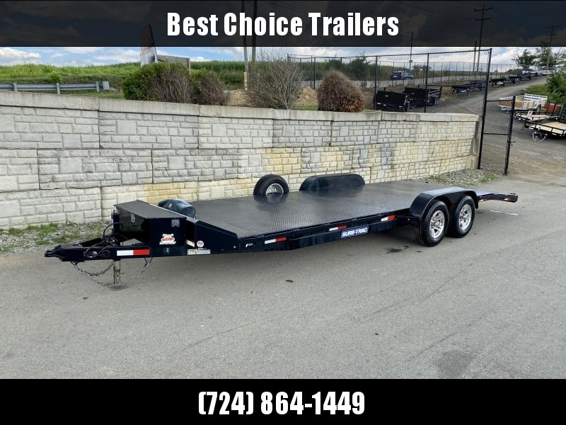 "USED 2018 Sure-Trac 7x24' Steel Deck Car Hauler 9900# GVW * 4' BEAVERTAIL * LOW LOAD ANGLE * ALUMINUM WHEELS * 5"" TUBE TONGUE/FRAME * AIR DAM * RUBRAIL/STAKE POCKETS/D-RINGS * REAR SLIDEOUT PUNCH PLATE RAMPS * TOOLBOX * SPARE TIRE * WINCH"
