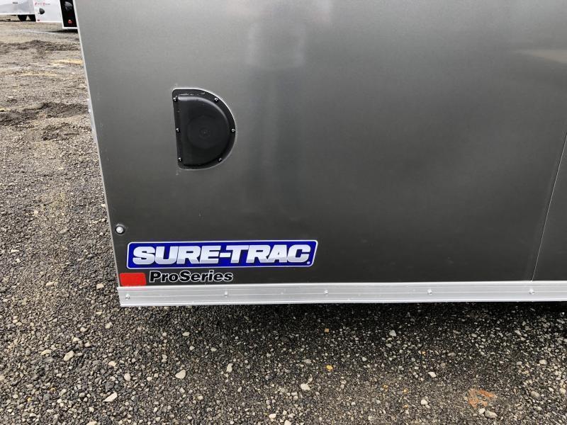 "2021 Sure-Trac 8.5x20' Pro Series Enclosed Car Hauler Trailer 9900# GVW * TORSION AXLES * BACKUP LIGHTS * CHARCOAL EXTERIOR * V-NOSE * RAMP * 5200# AXLES * .030 SCREWLESS EXTERIOR * ALUMINUM WHEELS * 1 PC ROOF * 6"" FRAME * 16"" O.C. C/M * PLYWOOD * TUBE ST"