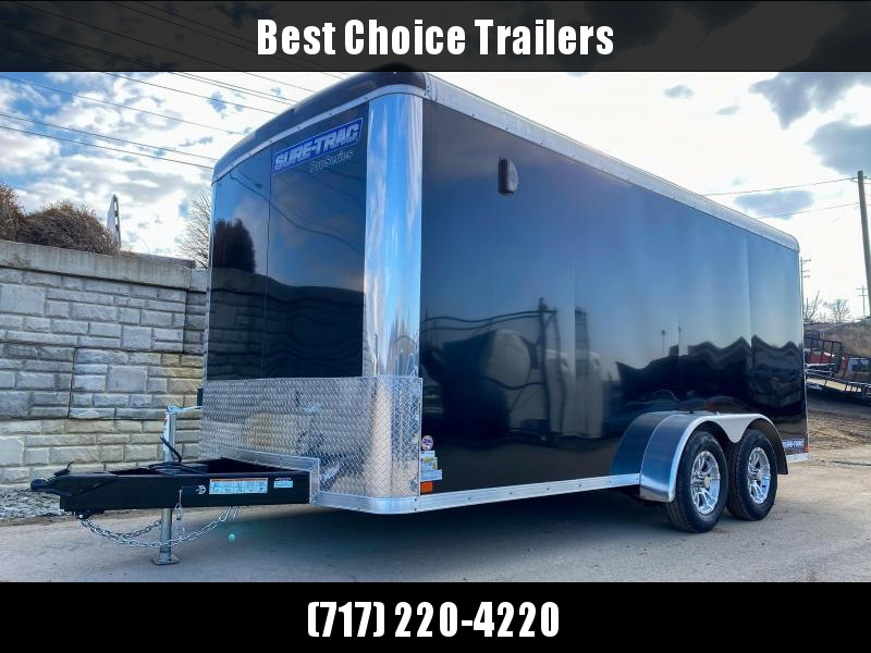"2021 Sure-Trac 7x16' Pro Series Enclosed Cargo Trailer 7000# GVW * CHARCOAL EXTERIOR * TORSION SUSPENSION * .030 SCREWLESS EXTERIOR * ROUND TOP * ALUMINUM WHEELS * 1 PC ROOF * 6'6"" HEIGHT * 6"" FRAME * 16"" O.C. C/M * PLYWOOD * TUBE STUDS"