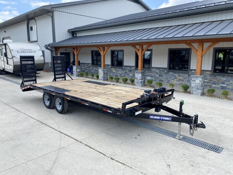 USED 2021 Sure-Trac 102x20 Beavertail Deckover Trailer 9900# GVW * STAND UP DELUXE RAMPS + SPRING ASSIST * TUBE SIDE RAIL + CROSSMEMBERS * RUBRAIL/STAKE POCKETS/D-RINGS * SPARE MOUNT * ADJUSTABLE COUPLER * DROP LEG JACK * WINCH