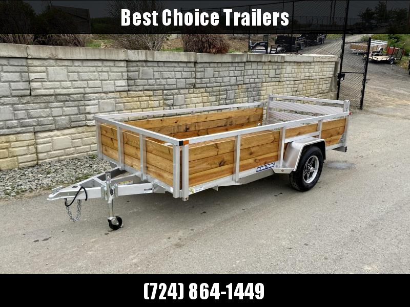 "2021 Sure Trac 7x12' Aluminum Wood High Side Utility Landscape Trailer 2990# GVW * 2' HIGH SIDES * BI FOLD GATE * ALUMINUM WHEELS * TUBE TOP * TRIPLE TUBE TONGUE * TUBE TONGUE * SWIVEL JACKS * STAKE POCKETS * EXTENDED 54"" GATE"