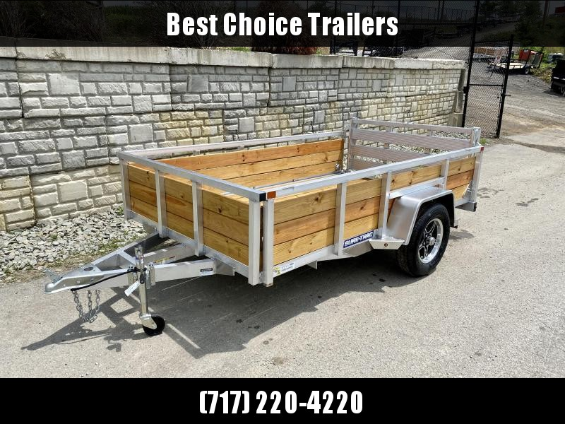 "2021 Sure Trac 6x10' Aluminum Wood High Side Utility Landscape Trailer 2990# GVW * 2' HIGH SIDES * BI FOLD GATE * ALUMINUM WHEELS * TUBE TOP * TRIPLE TUBE TONGUE * TUBE TONGUE * SWIVEL JACKS * STAKE POCKETS * EXTENDED 54"" GATE"