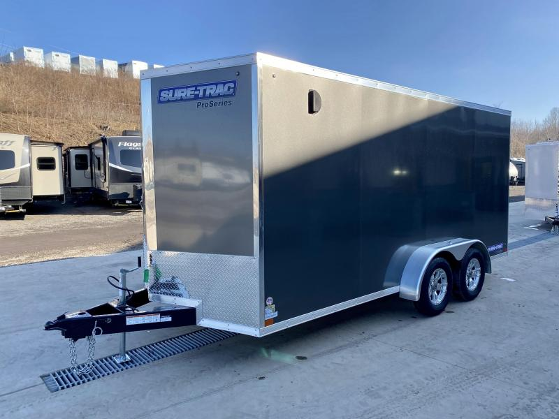 "2021 Sure-Trac 7x16' Pro Series Enclosed Cargo Trailer 7000# GVW * CHARCOAL EXTERIOR * V-NOSE * RAMP * .030 SCREWLESS EXTERIOR * ALUMINUM WHEELS * 1 PC ROOF * 6'6"" HEIGHT * 6"" FRAME * 16"" O.C. C/M * PLYWOOD * TUBE STUDS"