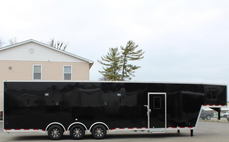 <b>IN PRODUCTION RACE CAR TRAILER W/MINI LIVING QUARTERS</b>  2022 Black 40' Millennium GN Race Car Trailer w/Tapered Nose