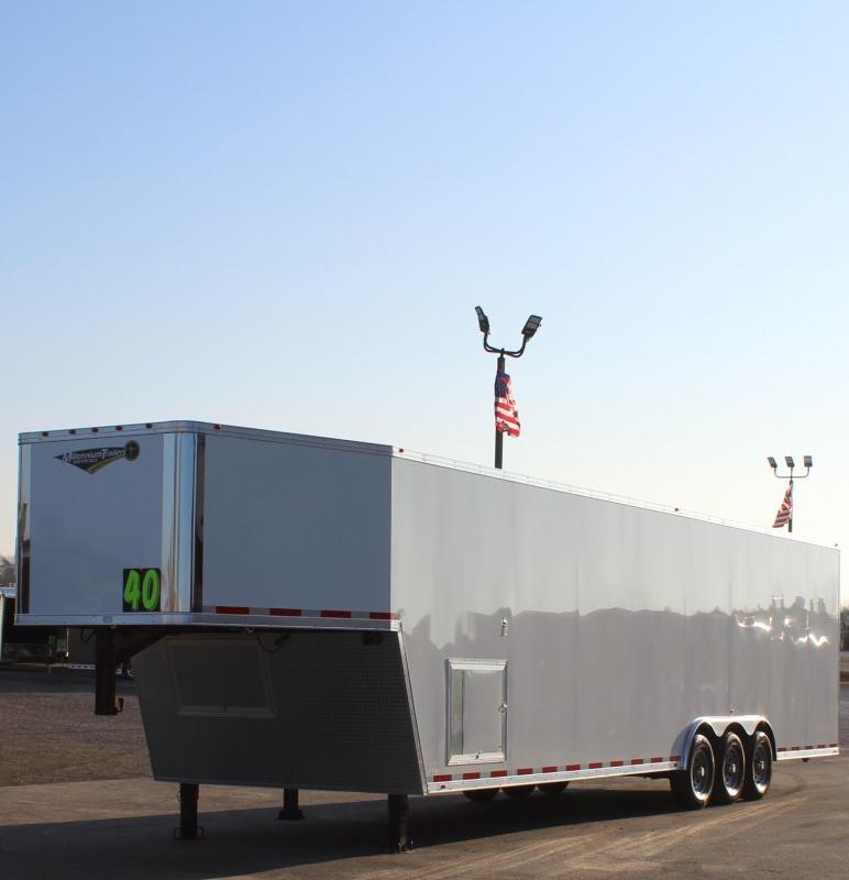 <b>NOW AVAILABLE</b>  2021 40' Millennium Silver Gooseneck Race Trailer .040 Screwless Ext./Hydraulic Jack/Cabinets