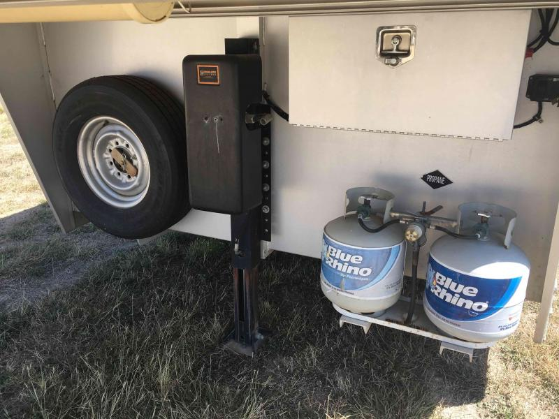 2013 Platinum Coach 4 Horse with a 14 ft Short Wall Horse Trailer