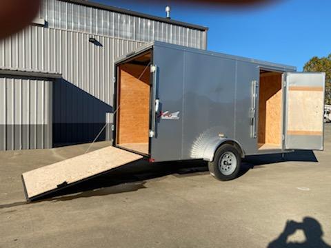 6x10 Enclosed Cargo Trailer With a ramp door.