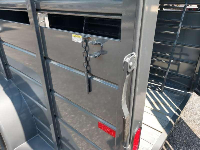 CMS6630-16 CM 6' X 16' STOCKER W/ CUT GATE AND COMBO REAR GATE W/ FULL WALK OUT ESCAPE DOOR.  SHOWN WITH OPTIONAL SPARE TIRE