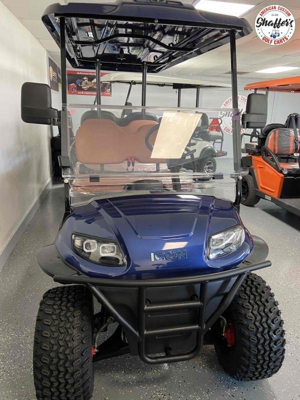 2021 ICON Indigo Blue i60L Lifted 6 passenger Golf Cart
