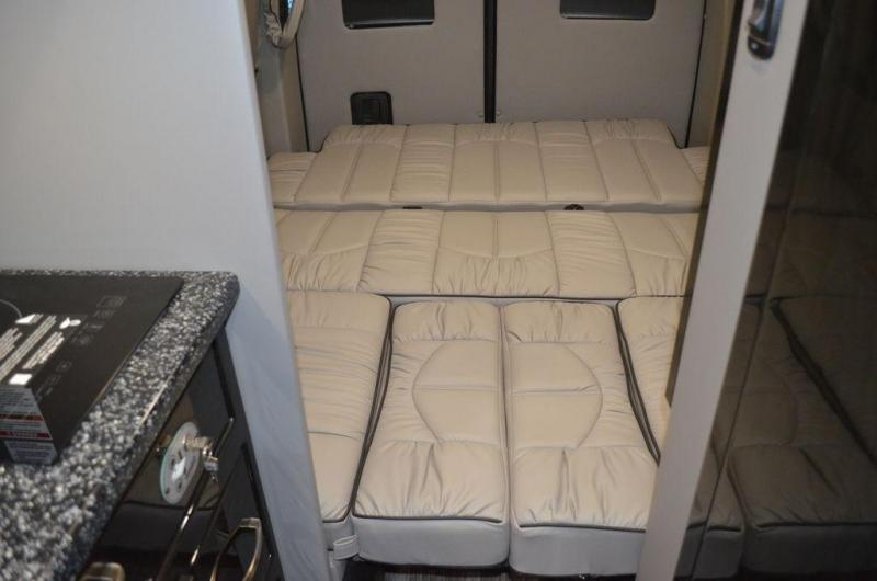 2021 Midwest Automotive Designs 4x4 Passage 144 SLEEPS 1-5 power drop bed with lounge and eco freedom