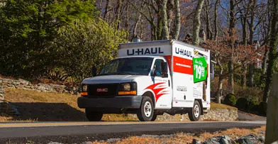 Small U-Hual truck in a suburb enviornment