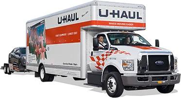 U-Haul truck towing a car trailer
