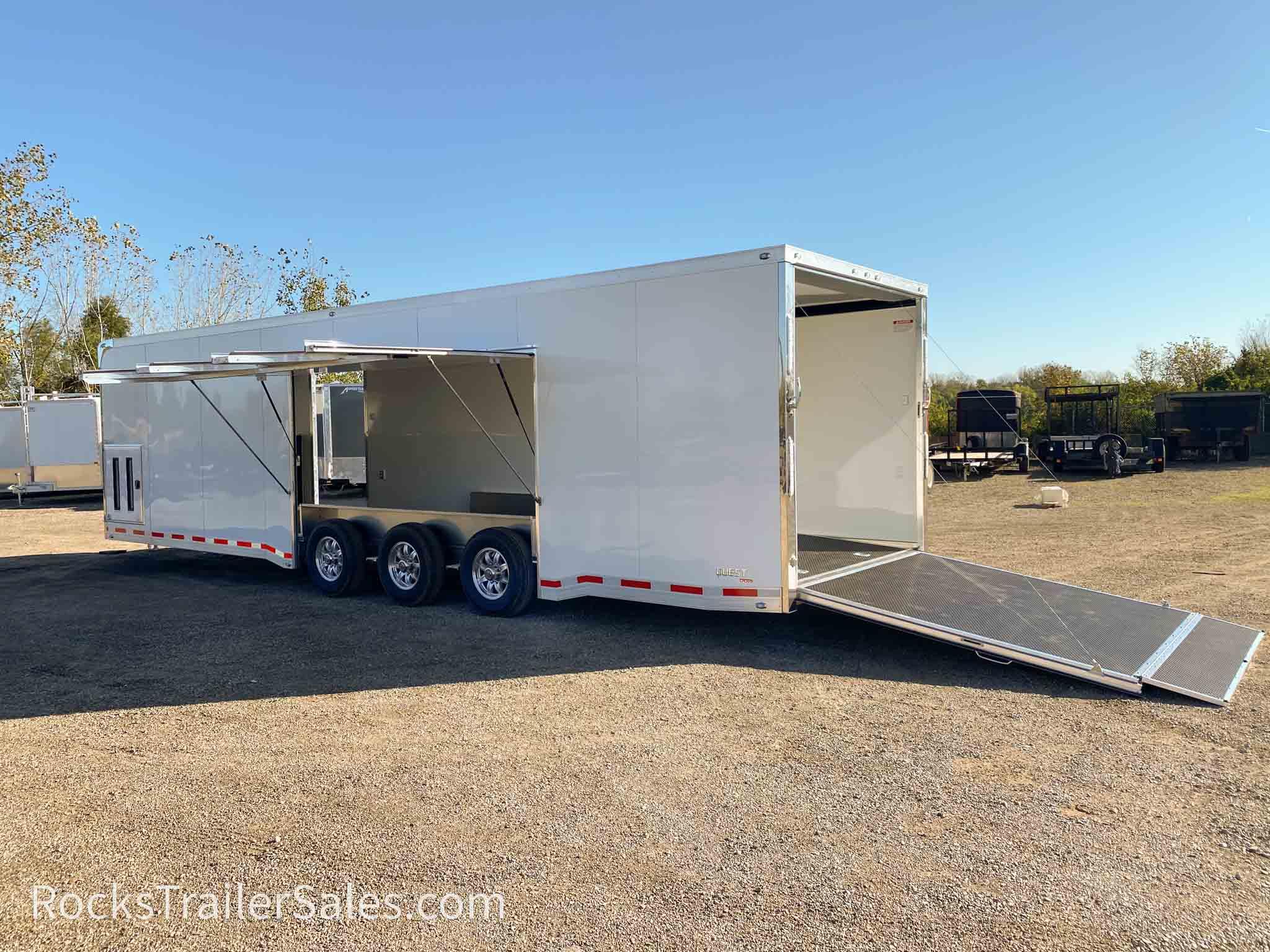 "32 ft quest tri axle car hauler with premium escape door "" width=""1200"" height=""900"