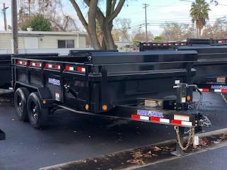 "2021 Load Trail 83"" X 12' Tandem Axle Dump Trailer"