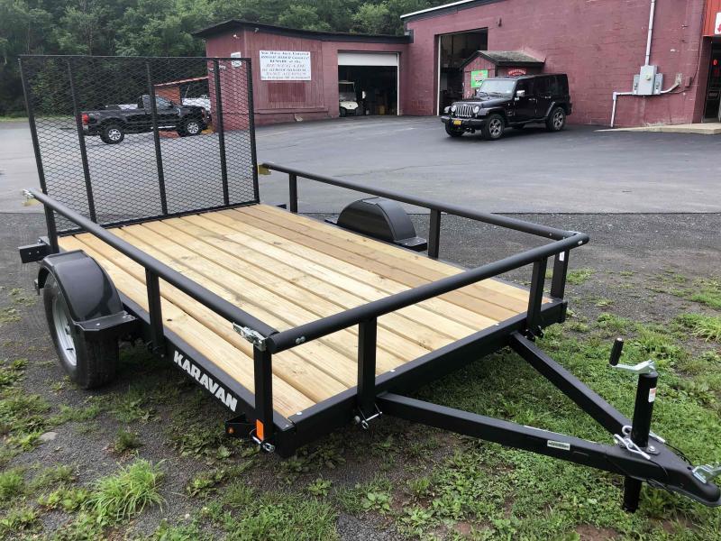 2022 Karavan Trailers KPU-2990-72-10RF Single Axle Utility Trailer. 6' Wide x 10' Long With 4' Mesh Gate.