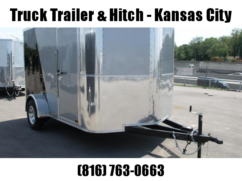 "Enclosed Trailer 7 X 10 Ramp 6' 3"" Height    All Tube Construction Two Tone Silver Mist Front/ Black Rear  In Color"