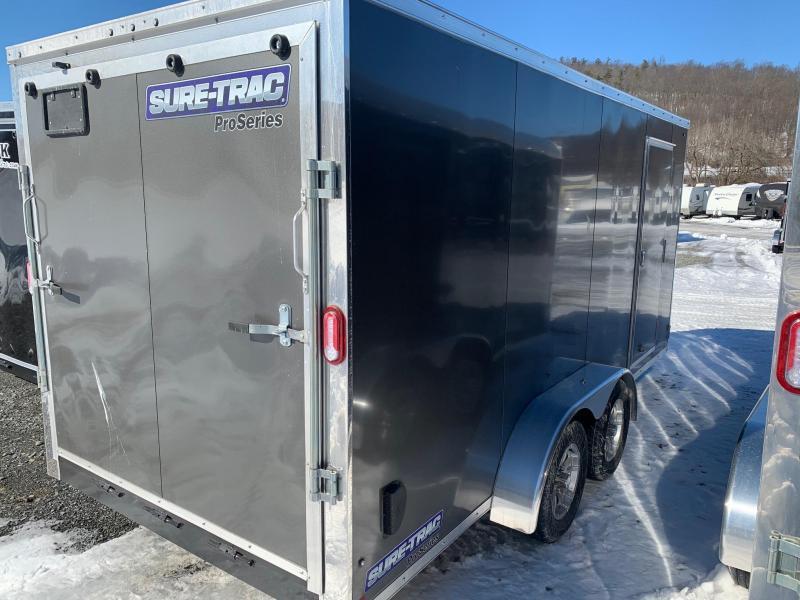 2021 SURE-TRAC 7x16 7k PRO SERIES WEDGE NOSE Cargo / Enclosed Trailer - Ramp - Screwless Exterior - RV Style Side Door - Aluminum Wheels - Plywood Walls - Aluminum H Trim Walls - LED Lights - STW8416TA
